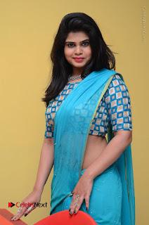 Telugu Actress Alekhya Stills in Green Saree at Swachh Hyderabad Cricket Press Meet  0044.JPG