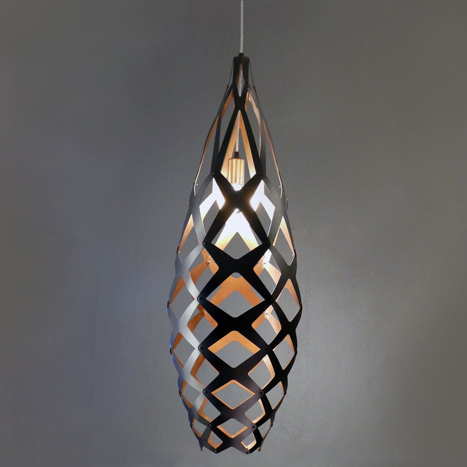 is of key home designing uniquelighting elements your chandelier how pendants sconces choosing give right decorating design space the expensive light tamela by a designs lighting or to when designer wall look one make can