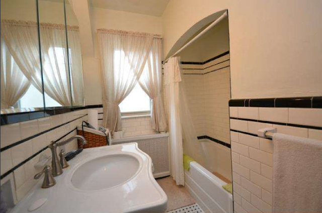bathroom with white subway tile with black tile trim in Sears Elmhurst 827 Green Lane, Secane, PA