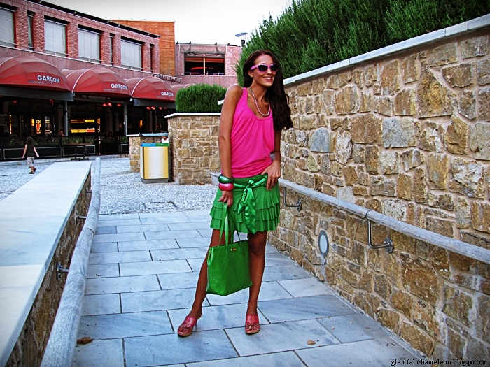 green skirt and purse, pink top and mules