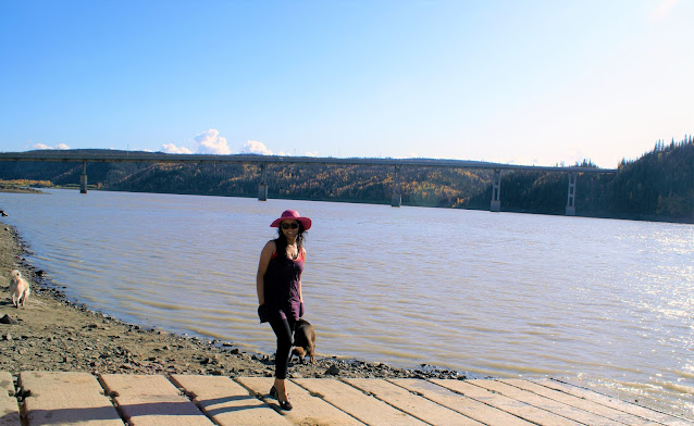 Lady and her dog at Yukon river in Alaska