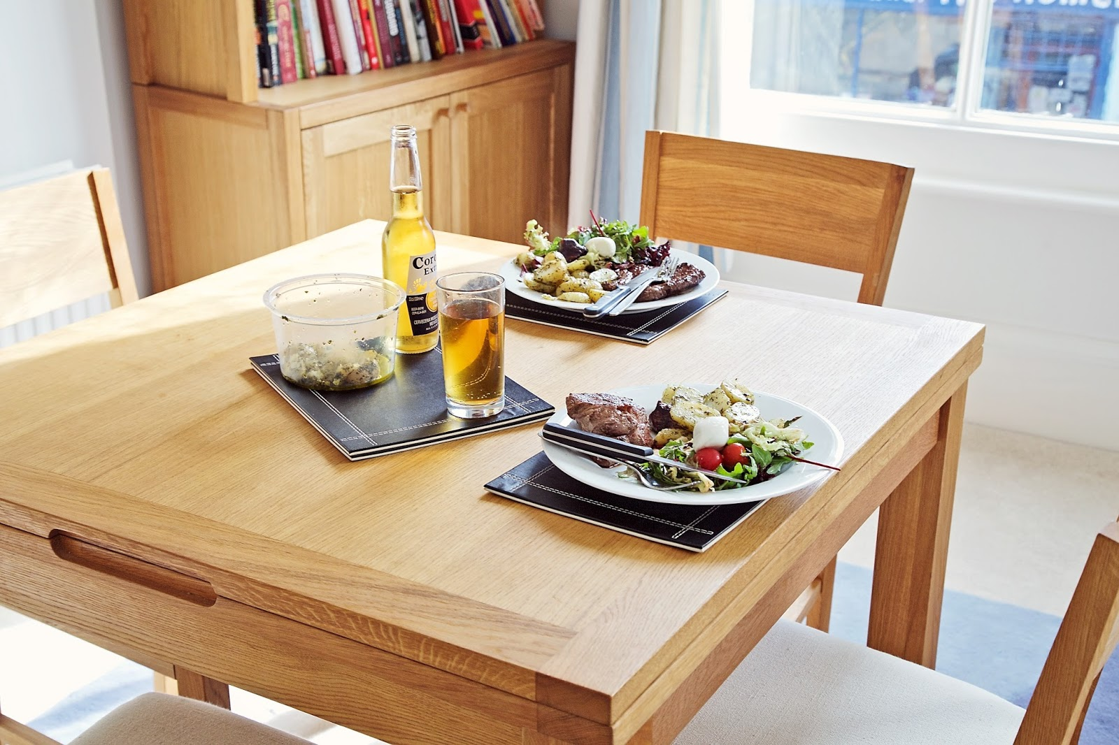 Home made steak and salad served on a dining table
