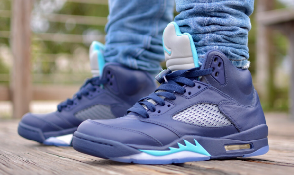 9ad73be0725 Taking cues from the Charlotte Hornets' colorways, the Air Jordan 5 Retro  will feature a predominately midnight navy upper, while accents of  turquoise blue ...