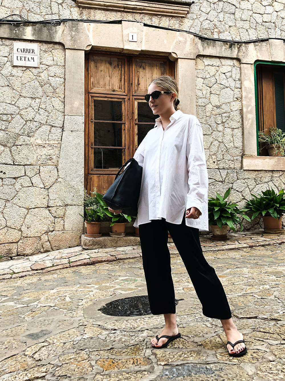 How to Wear Flip-Flop Sandals for Fall — Outfit with oversized white button-down shirt, cropped black pants, and black flip-flops