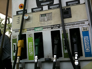 Gas pumps in Malayalam and English.