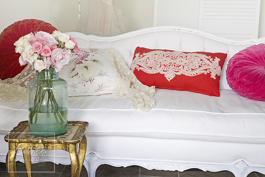 We mix and match throw pillows by pairing bright, bold reds and pinks with soft florals and neutral colors.