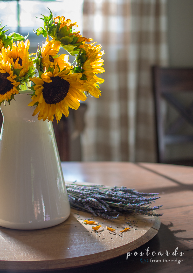 lavender bundle and sunflowers in a white enamel pitcher