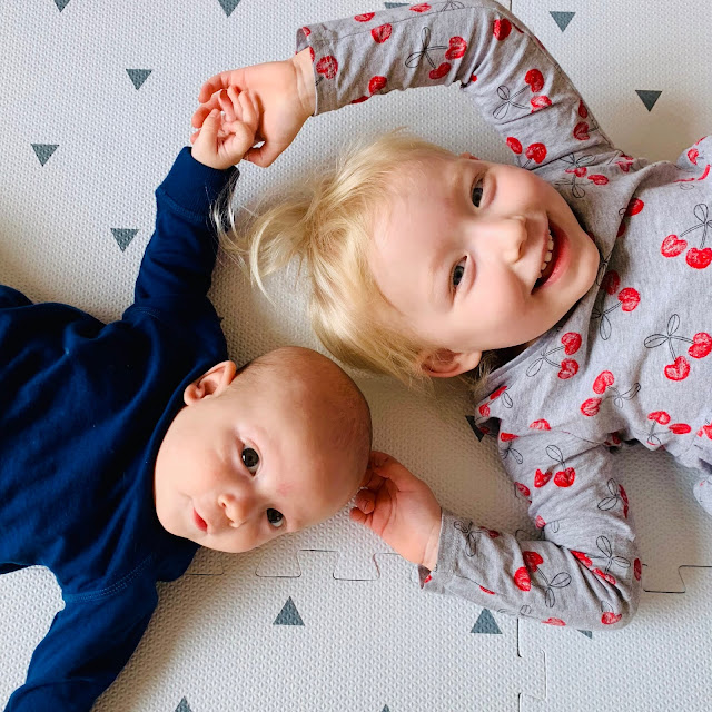 Siblings on Gus and Beau playmats