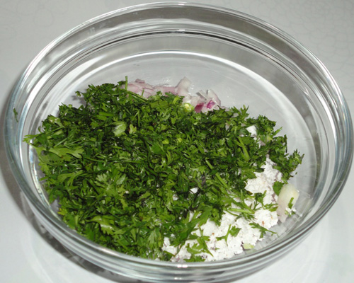 adding coriander leaves to make thalipeeth