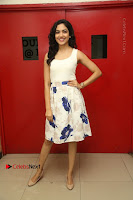 Actress Ritu Varma Stills in White Floral Short Dress at Kesava Movie Success Meet .COM 0011.JPG