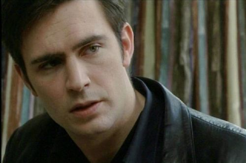 Jack Davenport in leather jacket