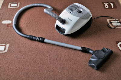 How is carpet cleaning different from rug cleaning