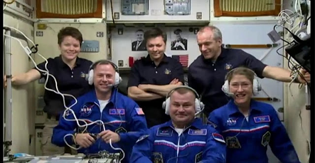 Expedition 59 crew members Anne McClain, Oleg Konoenko, and David Saint-Jacques welcome their new crew members, Nick Hague, Christina Koch, and Alexey Ovchinin, who arrived to the International Space Station on March 14, 2019. Image Credit: NASA TV