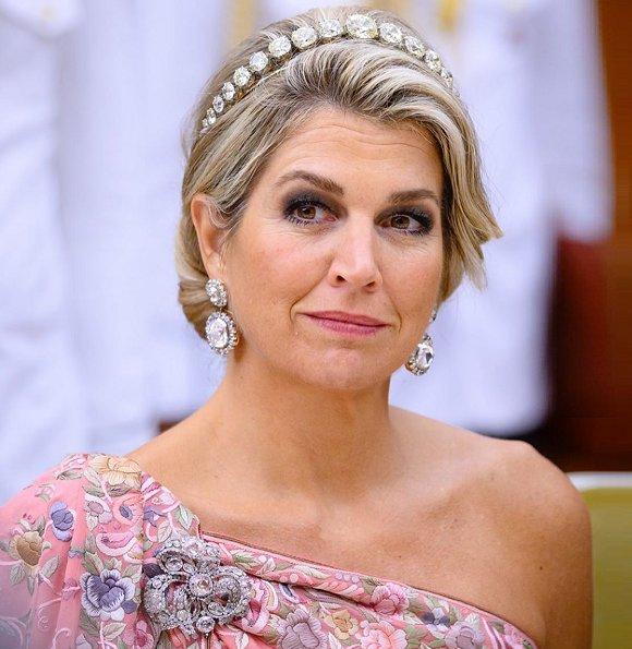 Queen Maxima wore a new bespoke evening gown by Jan Taminiau. Queen Maxima's diamond tiara and diamond earring