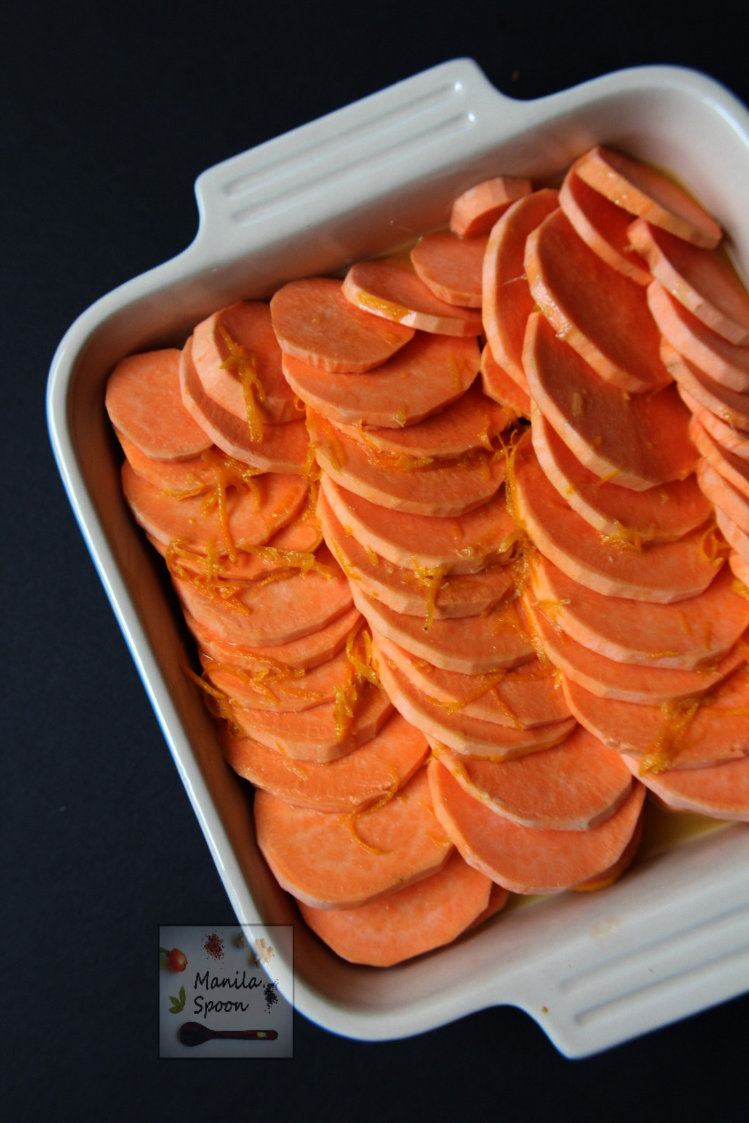 Flavored with honey and orange juice then studded with pecans this tasty Candied Sweet Potato Casserole is the perfect side dish for Thanksgiving. | manilaspoon.com