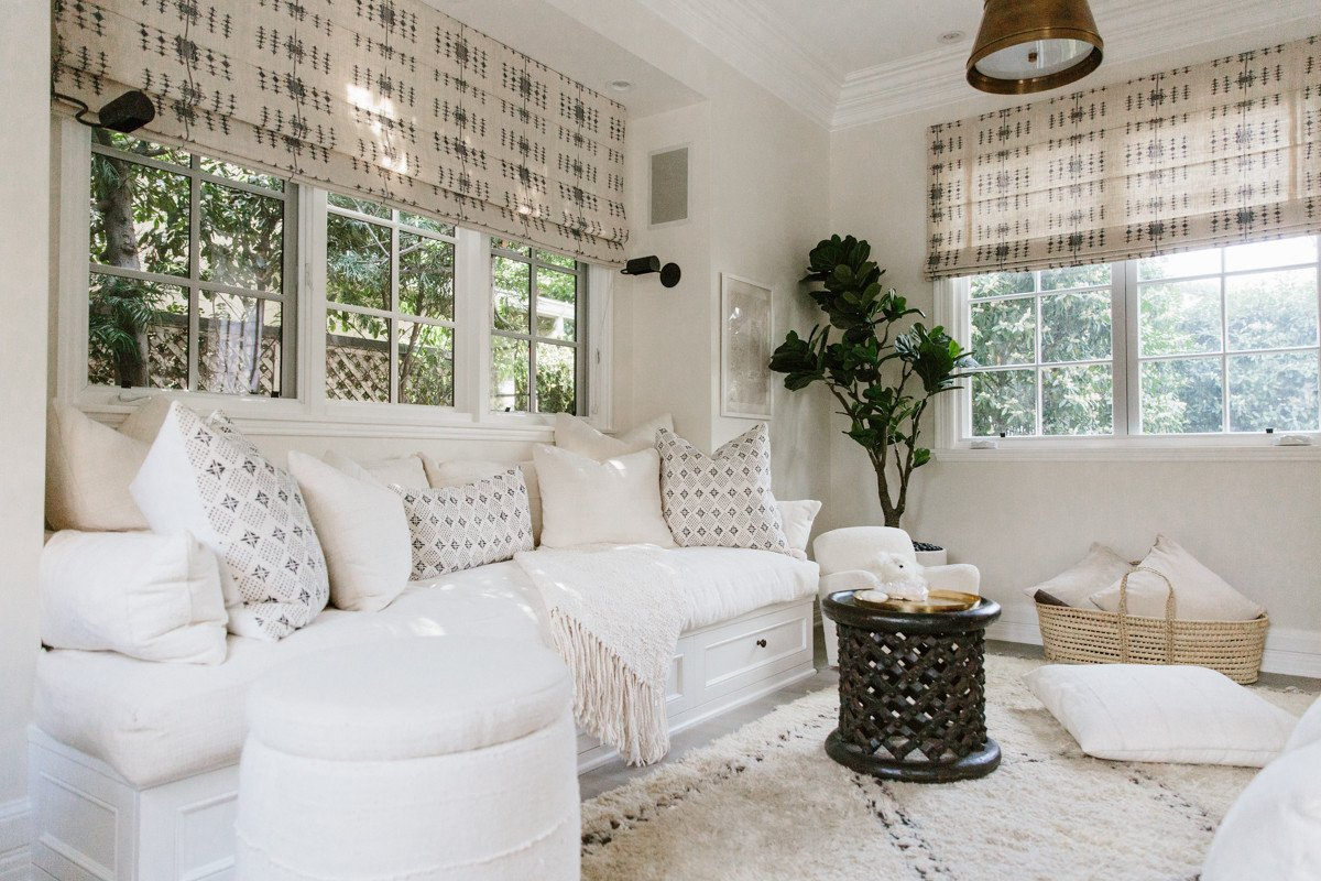 Daybed and mud cloth pillows in Erin Fetherston den. Come explore more California modern farmhouse design inspiration!