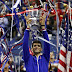 Novak Djokovic of Serbia holds up the U.S. Open trophy