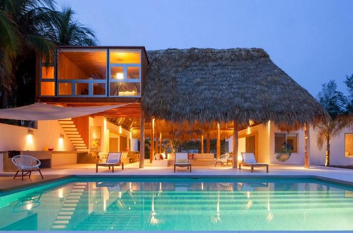 fachada de casa de madera y bambu