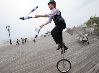 juggler on unicycle