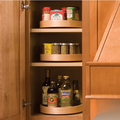 lazy Susans for spices, inside a cabinet