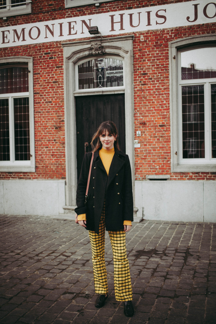 Outfit: yellow plaid trousers, Gucci belt, military coat and loafers