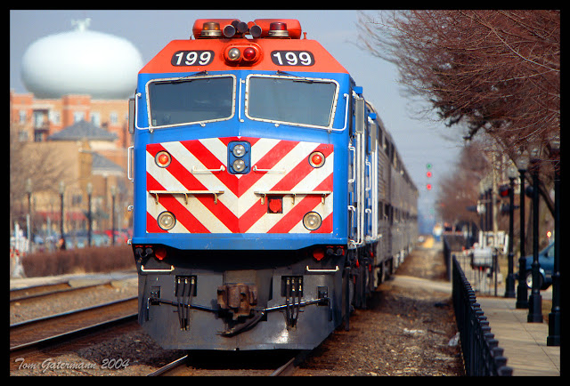 On March 13, 2004, METX 199 pushes a commuter train east out of the La Grange, IL. station.