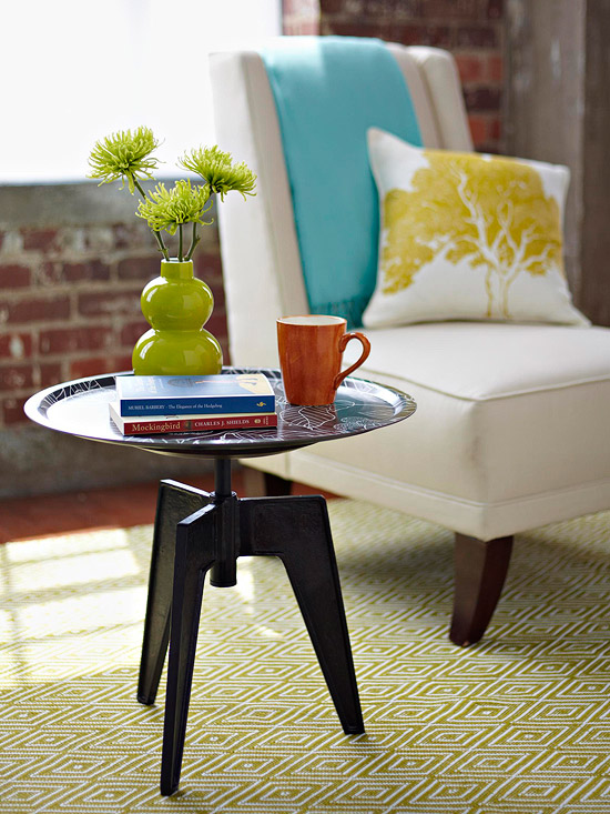 this side table was created from a upcycled stool base and vintage serving tray