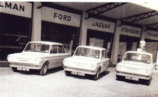 Hillman Imps outside the Cyril J Deal showroom