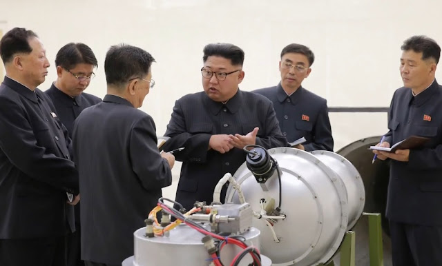 Image Attribute: Kim Jong-Un at the Nuclear Weapons Institute, inspecting what it said was a miniaturized H-bomb that could be fitted onto an intercontinental ballistic missile. / Source: KCNA