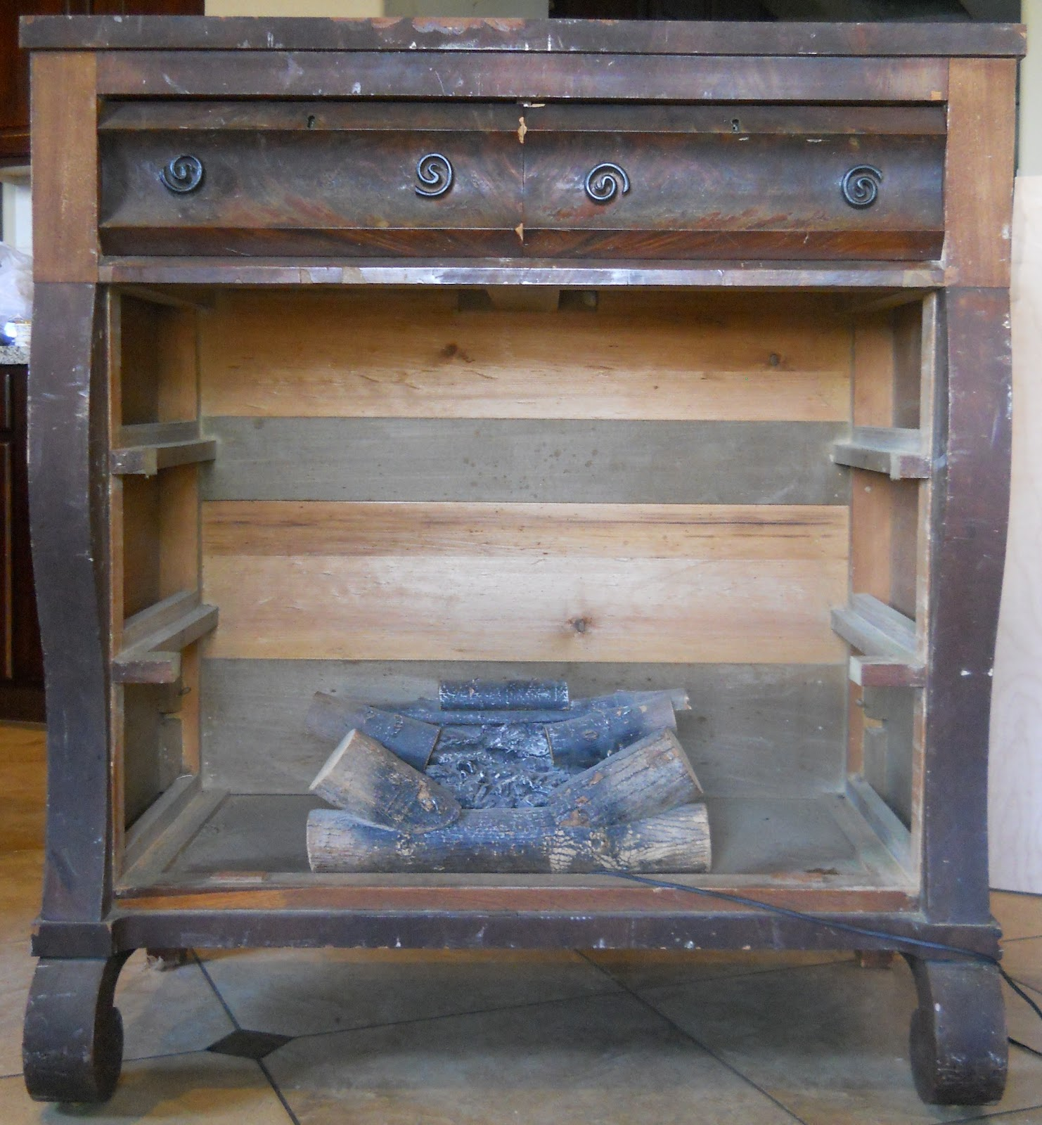 HOUSE UNDERCOVER: Old Dresser Turned Fireplace