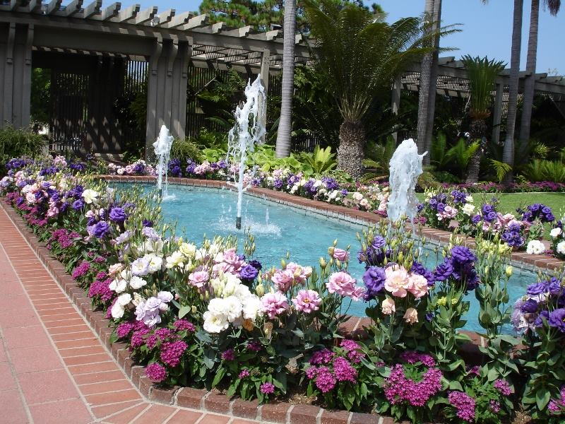 Sit Outdoors On The Veranda With Views Of Fountains, Garden Sculptures, And  Greenhouses At The Picturesque Rogers Gardens In Corona Del Mar