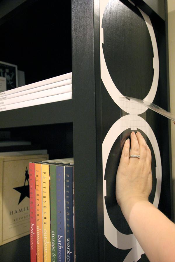 Applying interlocking circle detail to bookshelf