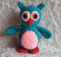 http://www.ravelry.com/patterns/library/hooty-the-baby-owl