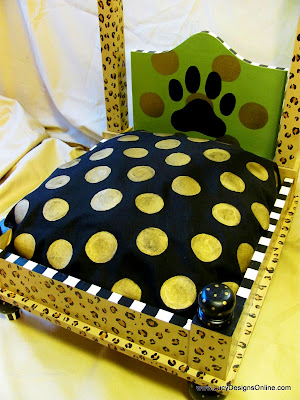 hand painted dog bed with cheetah or leopard print and custom cushions
