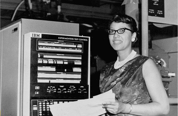 Melba Roy Mouton, pictured next to an electronic computer, was the leader of a group of human computers who helped track  Echo satellites in the early 1960s. NASA