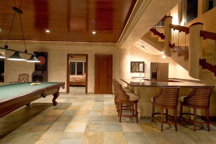 Entertainment room in Impressive Waterfall House in Hawaii