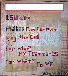 Freehand pieced words make Phillies baseball quilt back