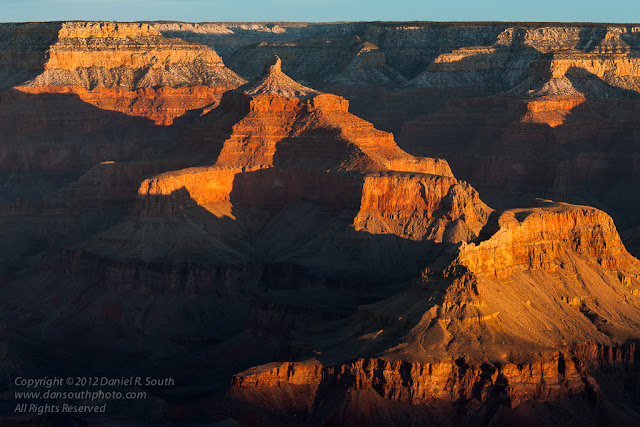 a photograph of grand canyon features with side lighting in the early morning