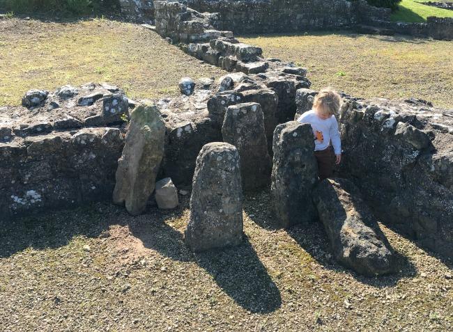 Toddler amongst ruins