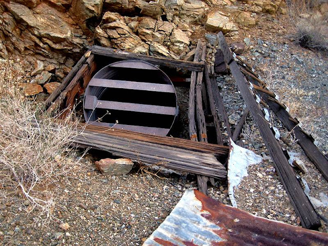 This incline shaft can be found on a hillside near an old mining camp, below the Silver Bell Mine.