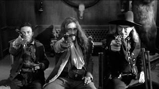 "The three legendary frontier killers: Cole Wilson, Conway Twill, Johnny ""The Kid"" Pickett hired by Dickinson, The Bounty Hunters, Dead Man, Directed by Jim Jarmusch"