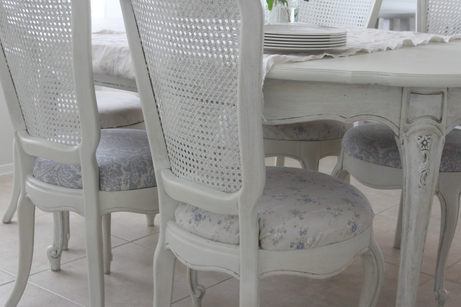 Round upholstered dining chair seats covered in a Shabby Chic Couture linen fabric - Hello Lovely Studio