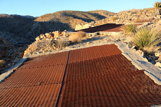 Covered mine shafts along the east canyon rim, Desert Queen Mine, Joshua Tree National Park