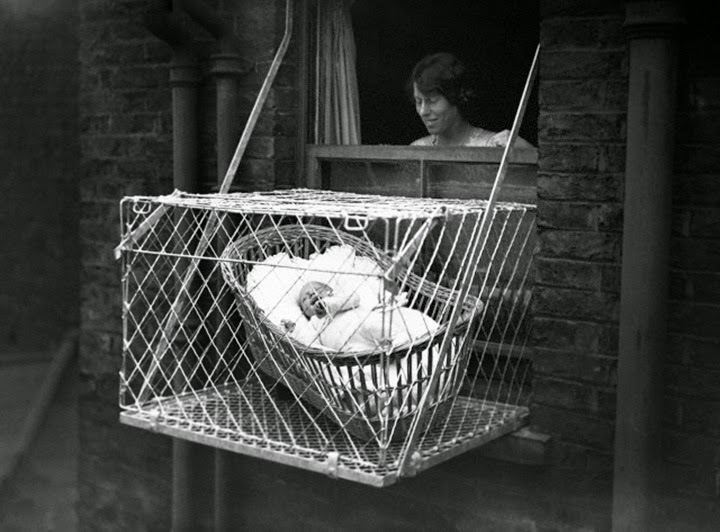 Incredible pictures of baby cages hanging outside london for Balcony meaning in english