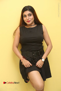 Tollywood Upcoming Actress Pooja Roshan Stills in Black Short Dress at Plus 1 Movie Trailer Launch  0165.JPG