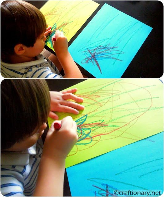 toddlers coloring on paper box