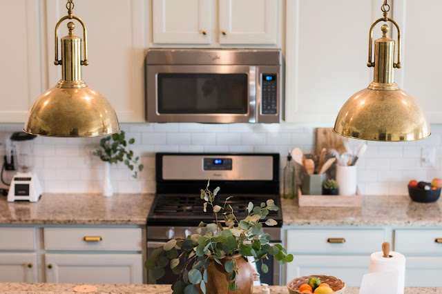 Sherwin Williams Austere Gray Kitchen Cabinets with Brass Pendants
