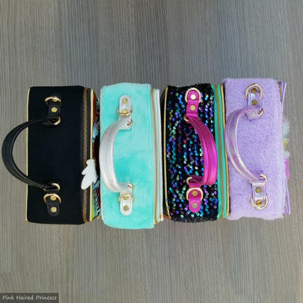 row of 4 irregular choice bags pictured from the top with handles