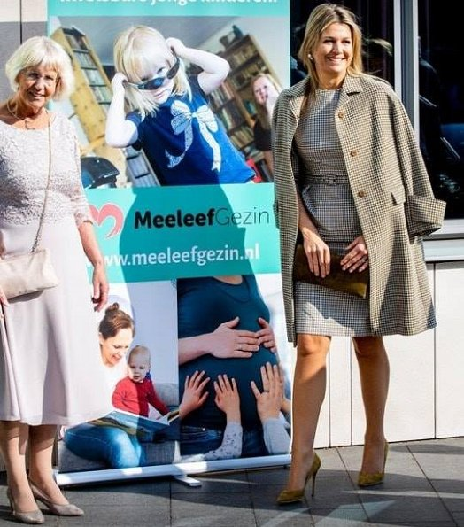Queen Maxima recycling a Natan combination of dress and coat