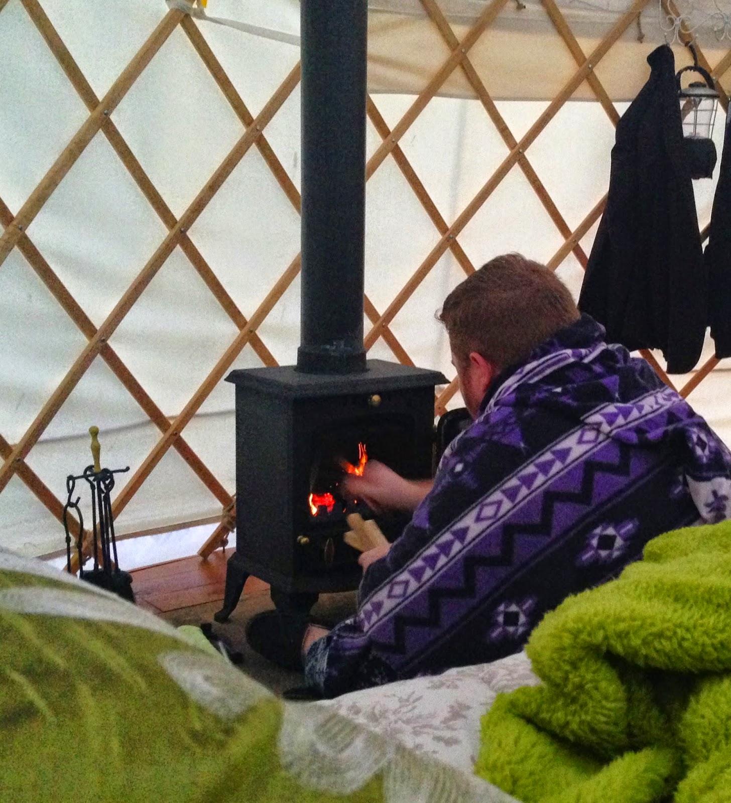 Acorn Glade - lighting the wood burning stove in yurt